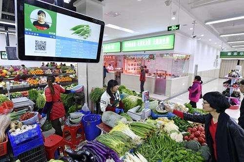 美媒: 中国率先进入无现金社会 手机当钱包令美国人惊讶